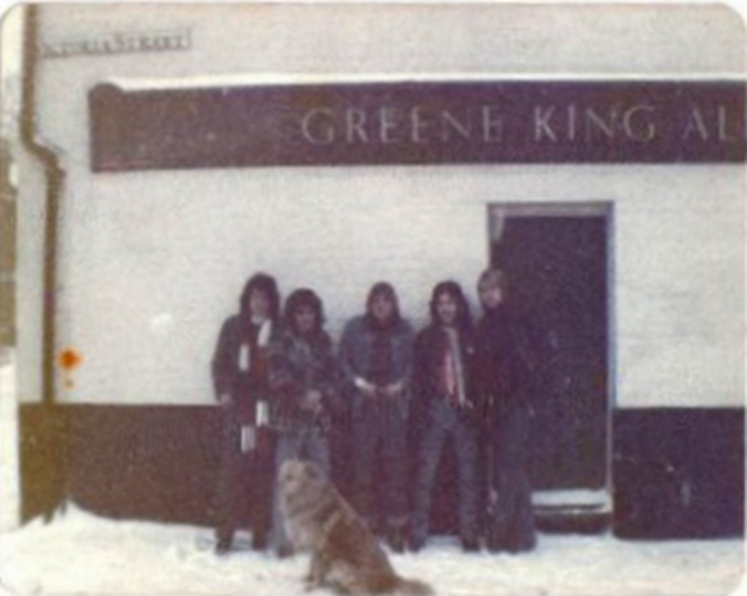 Outside the local pub, The Clarendon Arms Iron Maiden, December 31st 1978, right next to Spaceward Studios were The Soundhouse Tapes were recorded. From left to right: Paul Di'Anno, Paul Cairns with his dog, Nelson, Dave Murray, Steve Harris and Doug Sampson.